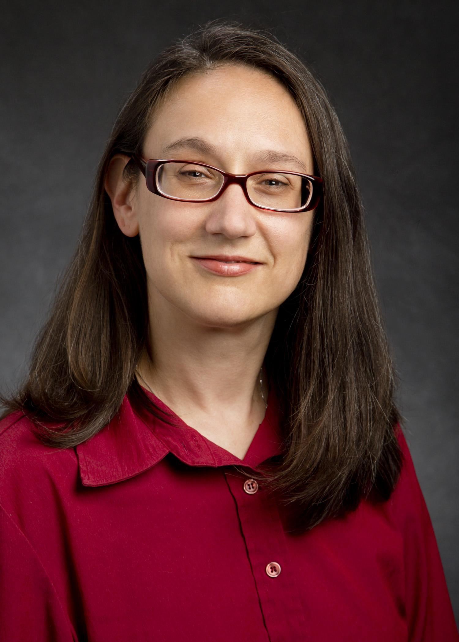 Image of Dr. Anita Hund wearing glasses and smiling.